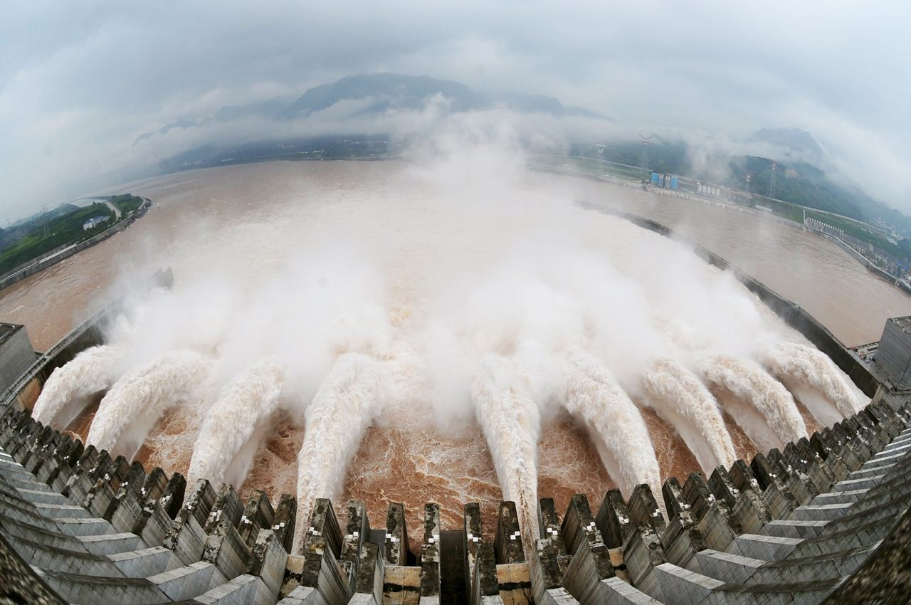 """(FILES) A picture taken on July 20, 2010 shows a release of water for flood prevention at the Three Gorges Dam in Yichang, central China's Hubei province, after relentless torrential rains hit Yangtze River areas. China's Three Gorges Dam has caused a host of ills that must be """"urgently"""" addressed, the government has said on May 19 2011, in a rare admission of problems in a project it has long praised as a world wonder. CHINA OUT AFP PHOTO FILES-CHINA-ENVIRONMENT-DAM-WATER"""